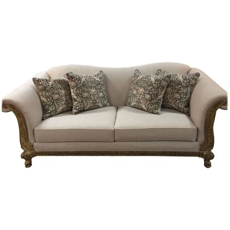 vintage sofa with wood carved trim and pillows at 1stdibs