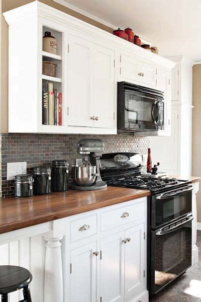 grey kitchen cabinets with black appliances black appliances and white or gray cabinets how to make 8358