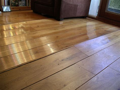 hardwood floors warping water damaged floor repair and restoration done right restoration