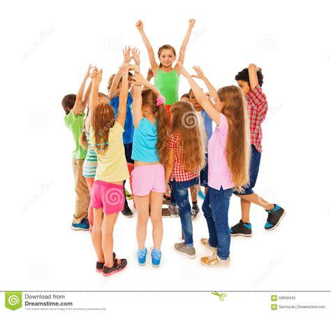 class leader girl raised hands  circle  mates stock