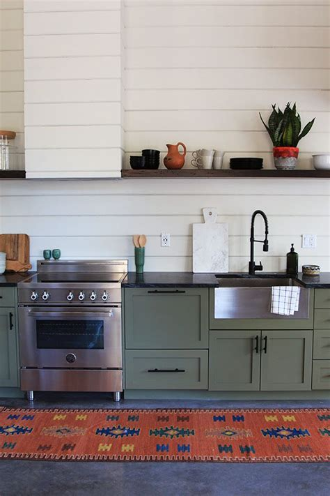kitchen wood backsplash green cabinets in the kitchen 3502