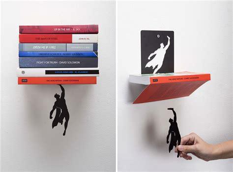 super hero bookend    books  falling