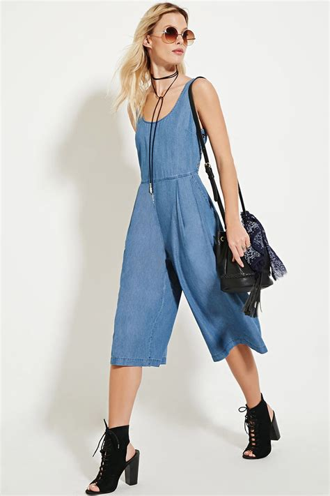 forever 21 denim jumpsuit lyst forever 21 chambray culotte jumpsuit in blue