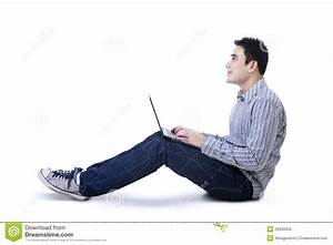 Happy Young Man Sitting On Floor With Laptop Stock Photo ...  Sitting