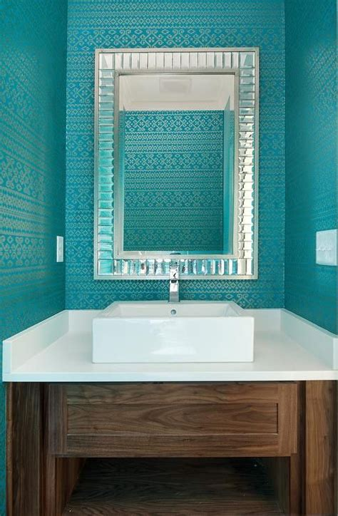 contemporary powder room features walls clad  turquoise