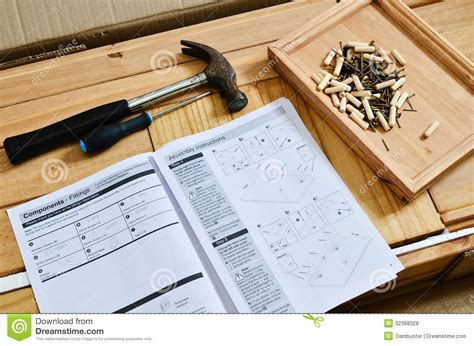 flat pack furniture stock photo image  guide hand