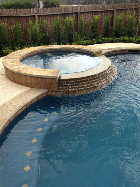 inground swimming pooltile raised spastacked stone spa