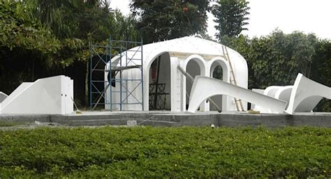company builds hobbit houses