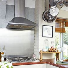 Rustic Country Kitchen With Stainless Steel Splashback And
