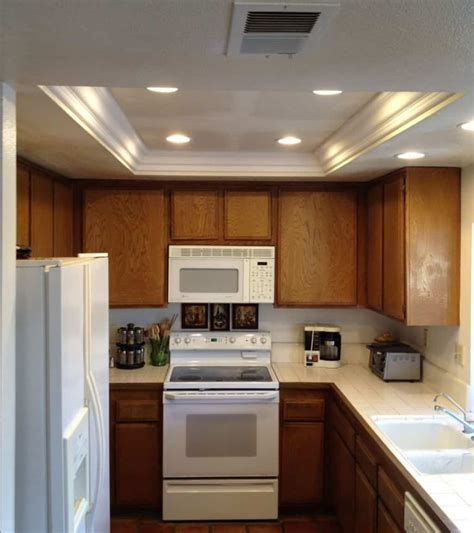 Recessed Lighting Layout Galley Kitchen by Small Kitchen Illuminated With Recessed Tray Ceiling