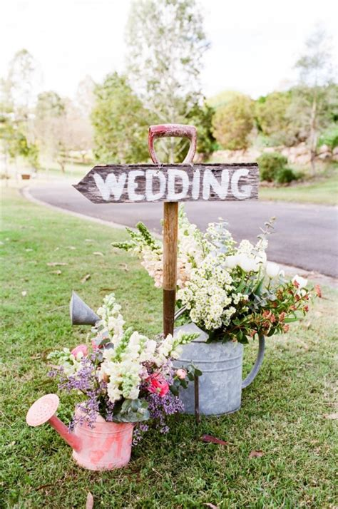 18 awesome rustic country wedding ideas to use watering cans - Country Backyard Wedding Ideas