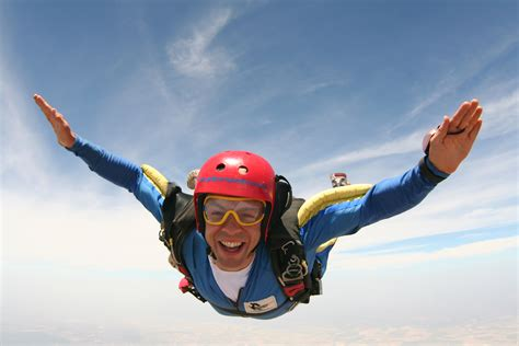 Parachute Dive by Counting The Best Places To Skydive In New Zealand