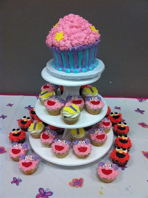 Abby Cadabby cupcake tower with Elmo | Elmo cupcakes, Elmo ...