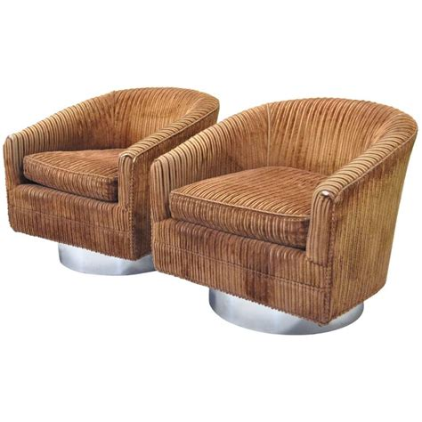 pair of swivel barrel back club or lounge chairs