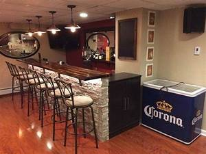 Man turns unfinished basement into the ultimate bar for Diy basement bars