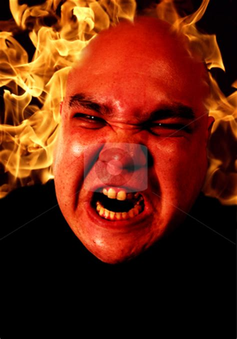 angry man  flames stock photo