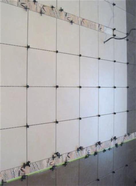 pose de carrelage mural salle de bain bricomarch 233 77