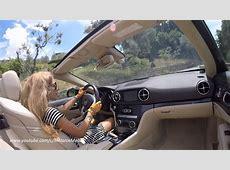 Joyride Girl driving a SL through the hills of Tuscany