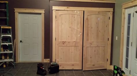 closet doors knotty pine arched ridged doors  lowes