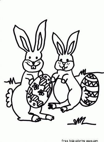 printable easter bunny hiding eggs coloring page  kidsfree printable coloring pages  kids