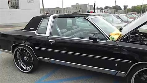 Black T-Top Oldsmobile Cutlass Supreme on Asanti's - YouTube