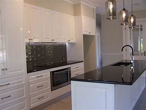 this kitchen features jet black granite benchtops with With kitchen colors with white cabinets with vinyl wrap wall art