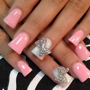 Baby pink acrylic nail art with accent d bow design