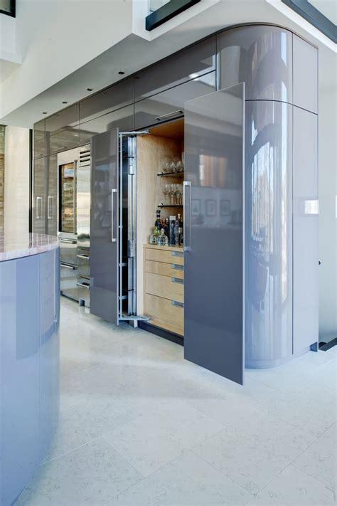 hidden liquor cabinet Kitchen Contemporary with bar