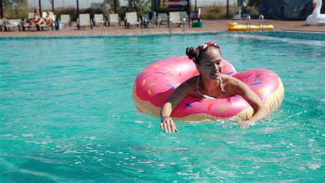 Girlfriends Swim In Rubber Rings With Alcohol In Hands In