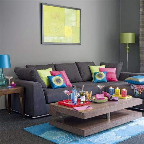 grey living room grey sofas colourful cushions