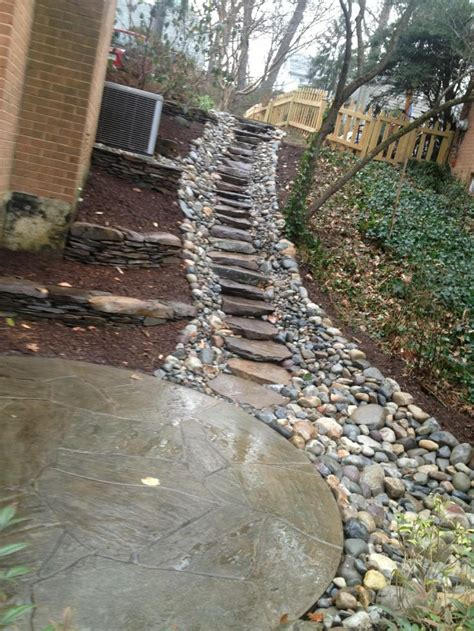 backyard drainage solutions create a sturdy yet attractive walkway on any slope with stone and gravel repin if this path