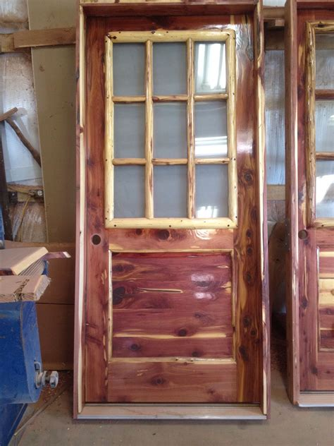 rustic red aromatic cedar entry door  log window frame