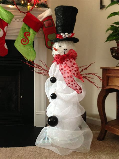 cracker barrel christmas decore cracker barrel snowman with deco mesh wrapped around large glass vase ornaments for