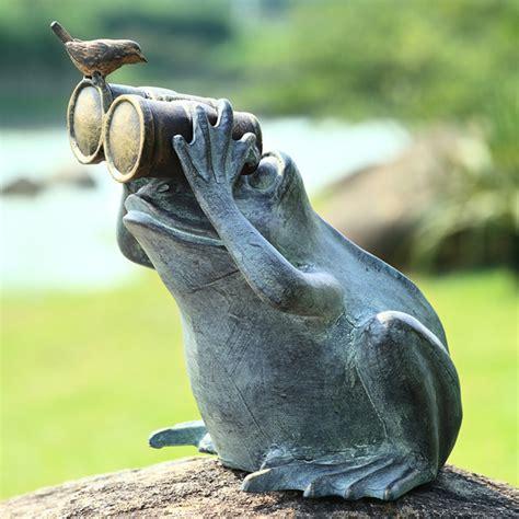 frog spectator with bird garden statue eclectic garden