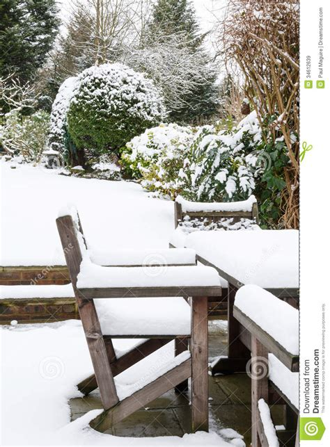 garden furniture  snow royalty  stock images