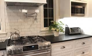 kitchen backsplashs black countertop white subway tile backsplash