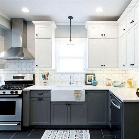 charcoal grey bottom cabinets  white top cabinets  dark hardware kitchen cabinet design