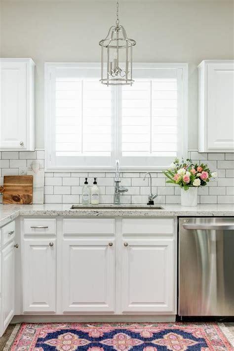 white kitchen cabinets subway tile backsplash chic white kitchen features white cabinets paired with 2059