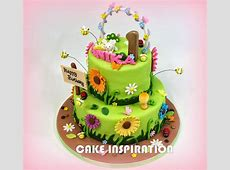 A SIMPLE AND BEAUTIFUL CAKE WITH COLORFUL DAISIES, BEES