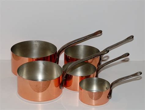 vintage french graduated copper cookware set