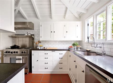 White Kitchen Cupboards With Black Countertops by Black Kitchen Countertops Inspiration Photos