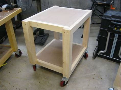 shop table on wheels easy shop table planer table 6 adding the casters and