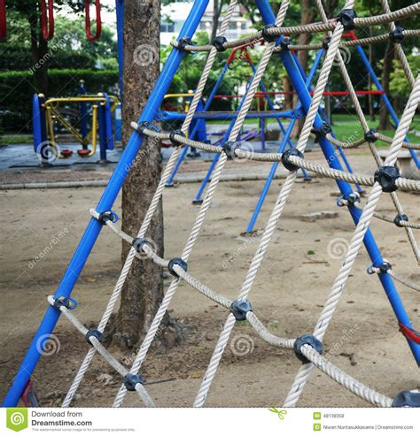 Climbing The Net At The Playground Stock Photo  Image Of