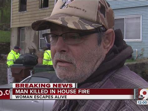 man dead  covington fire woman escapes
