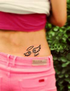 cute comic style angel wing tattoo on the lower back ...