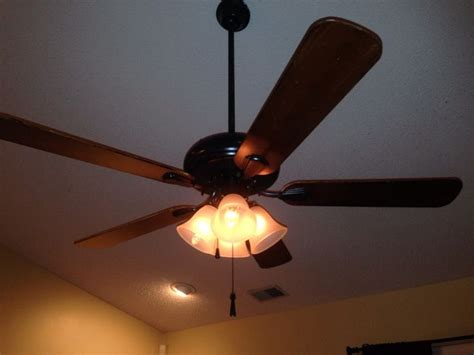 painting ceiling fan blades spray painted white ceiling fan with gold trim used a