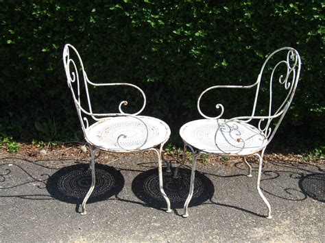 g096 s pair antique wrought iron garden chairs