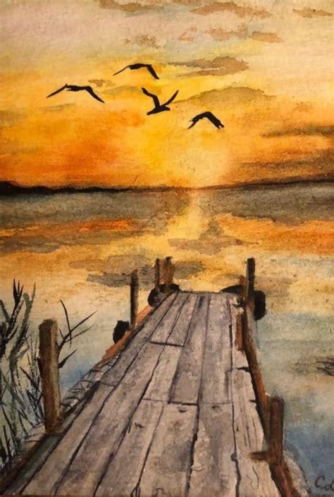 au premier plan je voie  magnifique couche de soleil