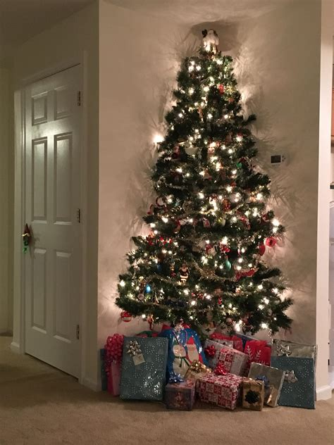 corner christmas tree my parents a corner fit artificial tree mildlyinteresting