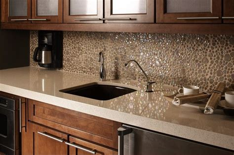 Light quartz countertops with dark honey maple cabinets